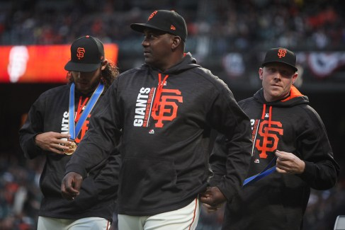 San Francisco Giants shortstop Brandon Crawford (35), USA, batting coach Hensley Meulens (31), NETHERLANDS head coach and pitcher Mark Melancon (41), USA, are acknowledged for their participation in the World Baseball Classic before the Arizona Diamondbacks face the San Francisco Giants at AT&T Park in San Francisco, Calif., on Tuesday April 11, 2017.
