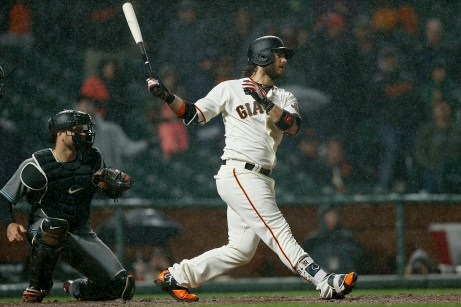 San Francisco Giants shortstop Brandon Crawford (35) strikes out to end the game as the Arizona Diamondbacks beat the San Francisco Giants 4-3 at AT&T Park in San Francisco, Calif., on Tuesday April 11, 2017.