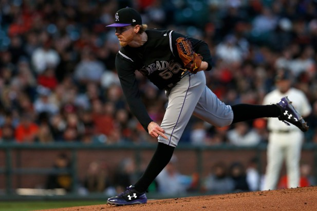 Colorado Rockies starting pitcher Jon Gray (55) follows through on a pitch in the first inning as the Colorado Rockies face the San Francisco Giants at AT&T Park in San Francisco, Calif., on Thursday, April 13, 2017.