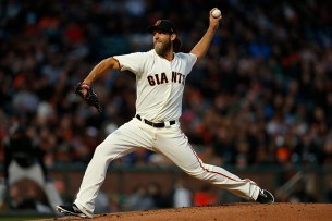 San Francisco Giants starting pitcher Madison Bumgarner (40) throws a pitch in the second inning as the Colorado Rockies face the San Francisco Giants at AT&T Park in San Francisco, Calif., on Thursday, April 13, 2017.