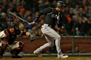 Colorado Rockies right fielder Carlos Gonzalez (5) singles in the fourth inning as the Colorado Rockies face the San Francisco Giants at AT&T Park in San Francisco, Calif., on Thursday, April 13, 2017.