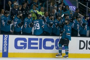 San Jose Sharks defenseman David Schlemko (5) is congratulated after a third period goal as the Edmonton Oilers take on the San Jose Sharks at the SAP Center in San Jose, Calif., on Tuesday, April 18, 2017.