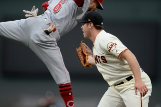 San Francisco Giants relief pitcher Ty Blach (50) tags out Cincinnati Reds center fielder Billy Hamilton (6) after hitting a dribbler in the infield in the first inning as the Cincinnati Reds face the San Francisco Giants at AT&T Park in San Francisco, Calif., on Thursday, May 11, 2017.