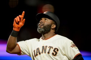 San Francisco Giants center fielder Denard Span (2) points to the sky after a home run in the fifth inning as the Cincinnati Reds face the San Francisco Giants at AT&T Park in San Francisco, Calif., on Thursday, May 11, 2017.