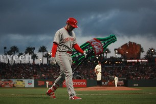 Cincinnati Reds left fielder Adam Duvall (23) walks back to the dugout after a strikeout as the Cincinnati Reds face the San Francisco Giants at AT&T Park in San Francisco, Calif., on Thursday, May 11, 2017.