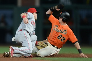 San Francisco Giants third baseman Christian Arroyo (22) is tagged out by Cincinnati Reds second baseman Scooter Gennett (4) in the fourth inning as the Cincinnati Reds face the San Francisco Giants at AT&T Park in San Francisco, Calif., on Friday, May 12, 2017.