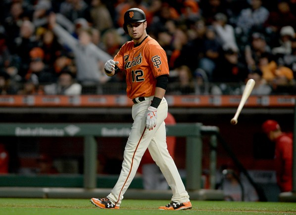 San Francisco Giants second baseman Joe Panik (12) reacts after hitting a line drive out in the fourth inning as the Cincinnati Reds face the San Francisco Giants at AT&T Park in San Francisco, Calif., on Friday, May 12, 2017.