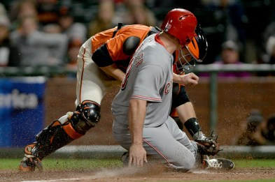 San Francisco Giants catcher Buster Posey (28) tags out Cincinnati Reds right fielder Scott Schebler (43) in the fourteenth inning as the Cincinnati Reds face the San Francisco Giants at AT&T Park in San Francisco, Calif., on Friday, May 12, 2017.