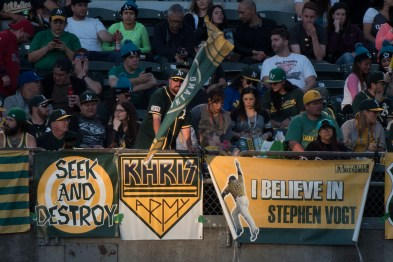 An Oakland Athletics fan waves a flag in support of the Athletics in the second inning of the game between the Athletics and the Boston Red Sox at the Oakland Coliseum in Oakland, Calif., on May 18, 2017.