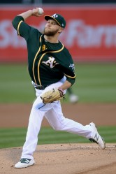 Oakland Athletics starting pitcher Jesse Hahn (32) throws a pitch in the first inning as the Toronto Blue Jays face the Oakland Athletics at Oakland Coliseum in Oakland, Calif., on Tuesday, June 6, 2017.