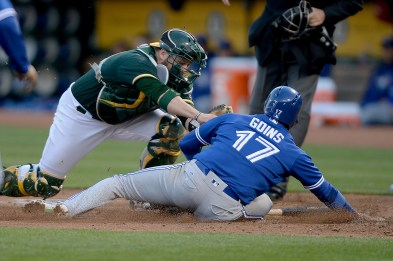 Oakland Athletics catcher Stephen Vogt (21) tags out Toronto Blue Jays second baseman Ryan Goins (17) in the third inning as the Toronto Blue Jays face the Oakland Athletics at Oakland Coliseum in Oakland, Calif., on Tuesday, June 6, 2017.