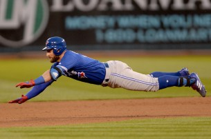 Toronto Blue Jays center fielder Kevin Pillar (11) is tagged out attempting to stretch a single into a double in the fifth inning as the Toronto Blue Jays face the Oakland Athletics at Oakland Coliseum in Oakland, Calif., on Tuesday, June 6, 2017.