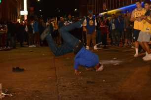 A Golden State Warriors fan break dances after the Warriors beat the Cleveland Cavaliers to win the NBA Finals in Oakland, Calif. on Monday, Jun. 12, 2017.
