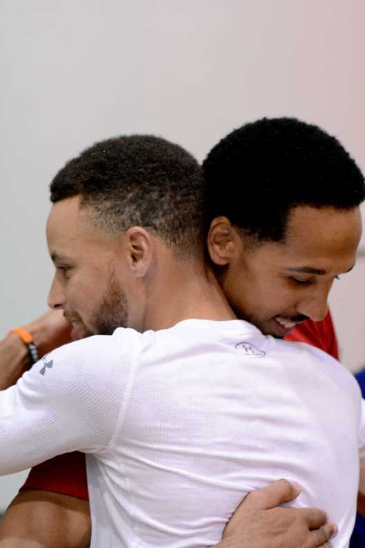Golden State Warriors G Stephen Curry (30-left) hugs G Shaun Livingston (34-right) during the Warriors end-of-season media session at their practice facility in Oakland, Calif. on Wednesday, Jun. 14, 2017. On Monday, the Warriors beat the Cleveland Cavaliers to win the NBA Finals.