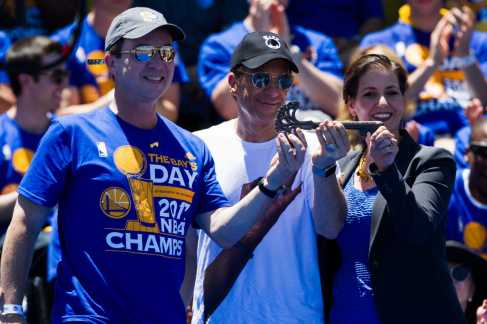 Oakland Mayor Libby Schaaf presents Golden State Warriors owners Joe Lacob (left) and Peter Guber with a key to the city at the Golden State Warriors 2017 NBA Championship rally in Oakland, Calif., on Thursday, June 15, 2017. (Brian Churchwell/SFBay)