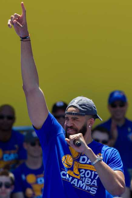 JaVale McGee salutes the crowd at the Golden State Warriors 2017 NBA Championship rally in Oakland, Calif., on Thursday, June 15, 2017. (Brian Churchwell/SFBay)