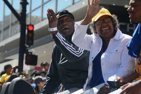 Alvin Attles (left), former Warriors player and coach, waves to the crowd as he rides on a car at the Golden State Warriors championship parade in Oakland, Calif. on Thursday, Jun. 15, 2017.