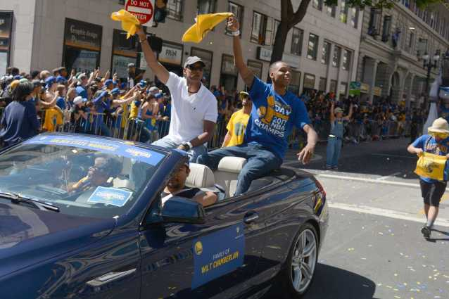 The family of the late NBA star and Warriors Center Wilt Chamberlain rides on a car at the Golden State Warriors championship parade in Oakland, Calif. on Thursday, Jun. 15, 2017.