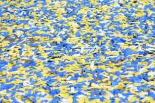 Ticker tape floods the street at the Golden State Warriors championship parade in Oakland, Calif. on Thursday, Jun. 15, 2017.