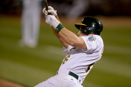Athletics third baseman Matt Chapman connects for a two-RBI single in the eighth inning of Oakland's 7-6 win over the New York Yankees Friday night.