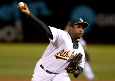 Oakland Athletics pitcher Santiago Casilla (46) throws a pitch in the ninth inning as the New York Yankees face the Oakland Athletics at Oakland Coliseum in Oakland, Calif., on Friday, June 16, 2017.
