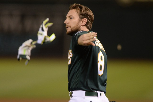 Oakland Athletics second baseman Jed Lowrie (8) reacts after striking out in the eighth inning as the Houston Astros face the Oakland Athletics at Oakland Coliseum in Oakland, Calif., on Wednesday, June 21, 2017.