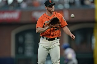 San Francisco Giants relief pitcher Ty Blach (50) gets a new ball after New York Mets left fielder Yoenis Cespedes (52) blasted a home run in the second inning as the New York Mets face the San Francisco Giants at AT&T Park in San Francisco, Calif., on Friday, June 23, 2017.