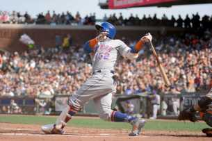 New York Mets left fielder Yoenis Cespedes (52) flies out in the first inning as the New York Mets face the San Francisco Giants at AT&T Park in San Francisco, Calif., on Friday, June 24, 2017.