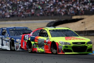 Monster Energy NASCAR Cup Series driver Dale Earnhardt Jr. (88) pulls away from Jamie McMurray (1) at the Toyota/Save Mart 350 at Sonoma Raceway in Sonoma, Calif., on Sunday, June 24, 2017.