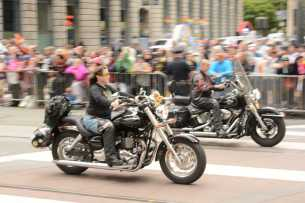 A woman rides a motorcycle at the Pride Celebration in San Francisco, Calif., on Sunday, June 25, 2017.