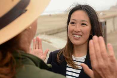 SF Supervisor Katy Tang (right) is sworn in as an Beach Buddy Jr. Ranger by Joy Lamarre (right), a Park Ranger involved in a beach volunteer outreach program at Ocean Beach in San Francisco, Calif., on Friday, June 30, 2017. SF Supervisors Katy Tang and Sandra Lee Fewer helped launch a pilot program to encourage people to throw their cigarettes away in receptacles instead of throwing them away on the streets.