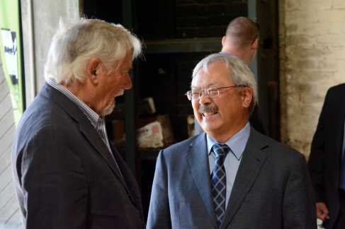 Mayor Ed Lee (right) smiles as he speaks at the Geneva Car Barn and Powerhouse in San Francisco, Calif., on Thursday, July 6, 2017.