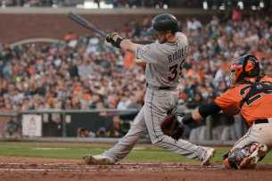 Miami Marlins shortstop JT Riddle (39) hits a two-run single in the first inning as the Miami Marlins face the San Francisco Giants at AT&T Park on Friday, July 7, 2017.