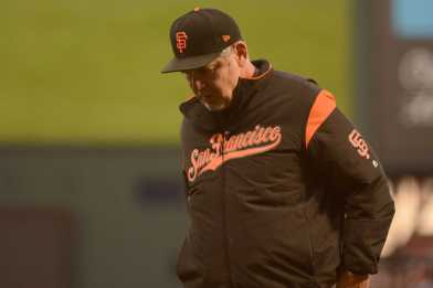 San Francisco Giants manager Bruce Bochy (15) walks off the field after a pitching change in the fourth inning as the Miami Marlins face the San Francisco Giants at AT&T Park on Friday, July 7, 2017.