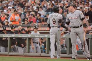 Miami Marlins second baseman Dee Gordon (9) scores on Marlins center fielder Christian Yelich's (21) double in the first inning as the Miami Marlins face the San Francisco Giants at AT&T Park on Friday, July 8, 2017.