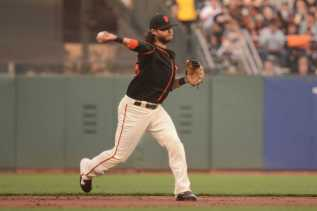 San Francisco Giants shortstop Brandon Crawford (35) throws to first base in the second inning as the Miami Marlins face the San Francisco Giants at AT&T Park on Friday, July 8, 2017.