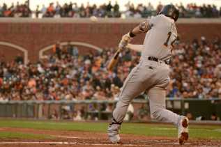 Miami Marlins third baseman Martin Prado (14) hits a foul ball in the fourth inning as the Miami Marlins face the San Francisco Giants at AT&T Park on Friday, July 8, 2017.