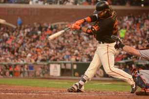 San Francisco Giants shortstop Brandon Crawford (35) hits a run-scoring single in the fourth inning as the Miami Marlins face the San Francisco Giants at AT&T Park on Friday, July 8, 2017.