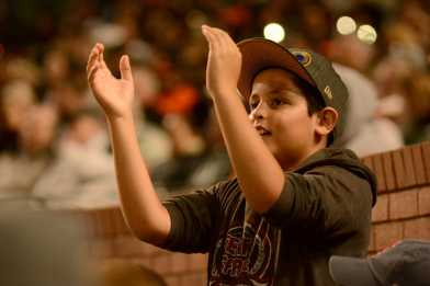 A young fan cheers as the Miami Marlins face the San Francisco Giants at AT&T Park on Friday, July 8, 2017.