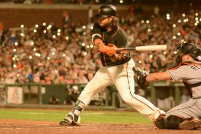San Francisco Giants shortstop Brandon Crawford (35) grounds out to second, scoring Giants outfielder Hunter Pence (8), as the Miami Marlins face the San Francisco Giants at AT&T Park on Friday, July 8, 2017.