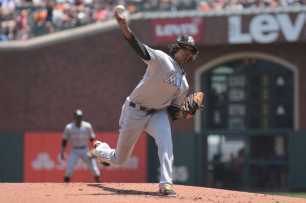 Miami Marlins pitcher Jose Urena (62) throws a pitch in the first inning as the Miami Marlins face the San Francisco Giants at AT&T Park on Friday, July 9, 2017.