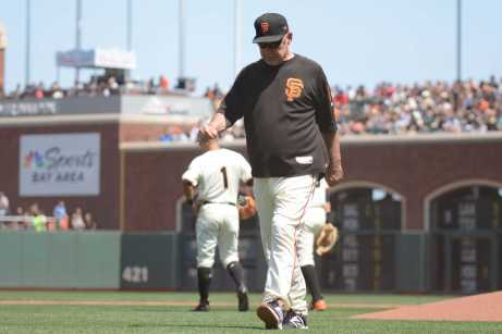 San Francisco Giants manager Bruce Bochy (15) leaves the mound after a pitching change as the Miami Marlins face the San Francisco Giants at AT&T Park on Friday, July 9, 2017.