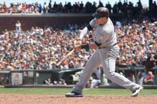 Miami Marlins first baseman Justin Bour (41) hits a single, scoring two runs, in the seventh inning as the Miami Marlins face the San Francisco Giants at AT&T Park on Friday, July 9, 2017.