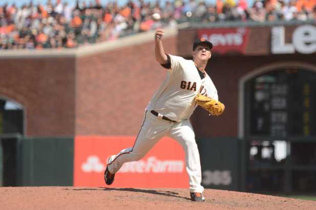 San Francisco Giants pitcher Matt Cain (18) throws a pitch in the eighth inning as the Miami Marlins face the San Francisco Giants at AT&T Park on Friday, July 9, 2017.