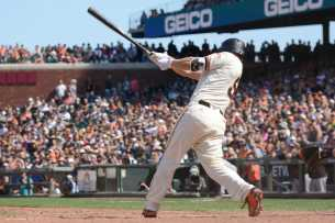 San Francisco Giants catcher Nick Hundley (5) hits a run-scoring single in the eighth inning as the Miami Marlins face the San Francisco Giants at AT&T Park on Friday, July 9, 2017.