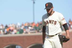 San Francisco Giants pitcher George Kontos (70) exits the field at the end of the eleventh inning, when he surrendered two home runs, as the Miami Marlins face the San Francisco Giants at AT&T Park on Friday, July 9, 2017.
