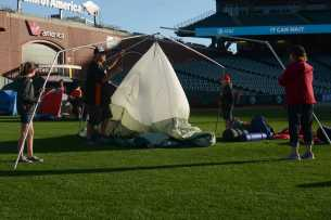 A family pitches a tent at the Giants slumber party after the Miami Marlins beat the San Francisco Giants at AT&T Park on Friday, July 9, 2017.