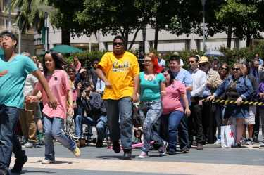 Students of Access SFUSD at the Arc, a community-based program for students with disabilities ages 18-22, dances towards the center of the stage to perform at the amateur portion of the 54th cable car bell ringing contest in Union Square in San Francisco, Calif., on Thursday, July 13, 2017.