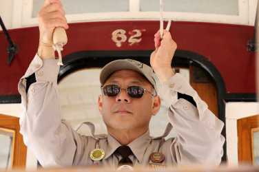 Joseph Sue, conductor at Cable Car Division for 16 years, tugs with grace during the 54th cable car bell ringing contest at Union Square in San Francisco, Calif., on Thursday, July 13, 2017.