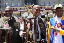 2017 cable car bell-ringing champion Bryan Cobb, center, stands next to 2016 champ Leonard Oats, left, and 10-time winner Carl Payne at Union Square in San Francisco, Calif., on , Thursday,July 13, 2017.